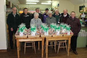 Members with the Christmas hampers ready to go out.