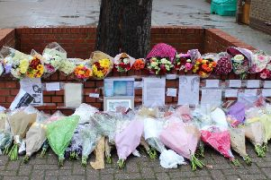 Some of the floral tributes left at St George's Academy in Sleaford to Eliza Bill.
