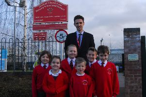 Headteacher Callum Clay and Church Lane School pupils celebrating being listed sixth in the county in the Real Schools Guide for 2019. EMN-190121-144942001