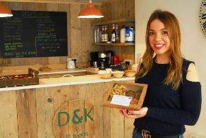 Kim Saddey with one of the healthy meal boxes created by her sister Dominique for their blossoming business, D and K Fit Foods, that has just opened in Sleaford. EMN-190124-181201001