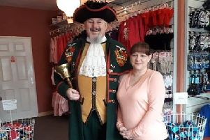 Shop owner Lorraine Buckley with Sleaford Town crier John Griffiths. EMN-190131-171708001