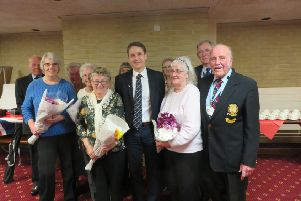 The group honoured for their membership and contributions.