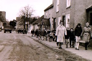 Children and staff troop along Ruskington High Street between their two school sites. EMN-190804-232034001