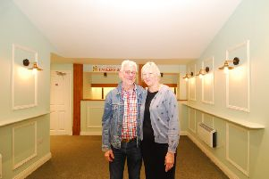 Project leaders Garry Goodge and Christine Malkin proudly survey the completed revamp of Sleaford Playhouse foyer area. EMN-190705-123537001