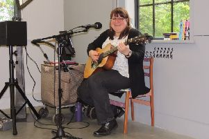 American singer/songwriter Lynn McFarland busking in the NCCD exhibition on Saturday. EMN-190605-124816001