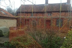 Scaffolding around Mrs Smith's Cottage at Navenby. EMN-190514-154414001
