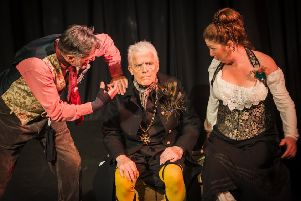 Very fetching in yellow stockings and crossed garters. Paul Sproxton as Malvolio with his tormentors Tony Gordon as Sir Toby Belch and Caroline Johnson as Maria. EMN-191005-110645001