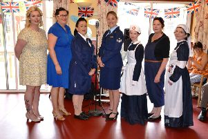Ashdene Care Home staff and singers in costume for their 1940s themed event for residents. EMN-191005-165240001