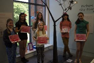 Illustrated story competition winners, pictured from left - Hanna Powell, Emily Allen, Ciara O'Beirne, Oskar McIntosh and Eleanor Woolner. Front: Eli McGee. EMN-190807-172956001