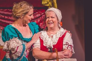 Nell and Nancy share a scene in this brilliant show at Sleaford Little Theatre. Photo: Sleaford Little Theatre.