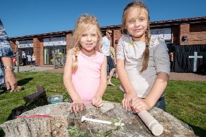 Pippa Webb age 5 and Millie Webb age 7 making clay art at the Touchwood Forest School stand EMN-190923-142105001