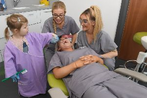 Sunday Funday at Treeline Dentists. L-R Millie Anderson 3, Eleanor Marriott - dental nurse, Lauren Foster - trainee dental nurse and Chelsea Foster - head nurse, in the chair. EMN-191125-111115001
