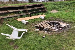 The remnants of the bonfire and damage at the scout hut. EMN-200601-160454001