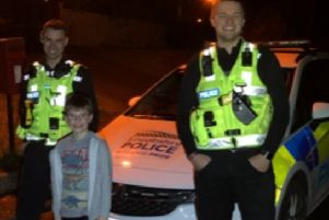 PC James Knychalas and PC Christopher Windsor-Beck with the delighted eight-year-old after they returned his stolen �80. EMN-200302-134215001