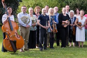 Some of the orchestra with their conductor for the concert Roderick Dunk. EMN-200131-172817001