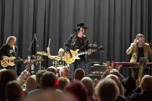 Slade performing at St George's Academy, Sleaford. EMN-200302-091502001