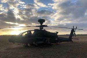 Olly Waite's photo of the downed Apache helicopter weathering the storm on Saturday evening.