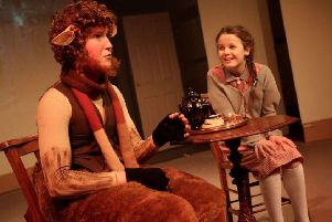 Lucy Pevensie (Anna Record) meets Mr Tumnus (Tom Carey). Picture by Stephen Candy