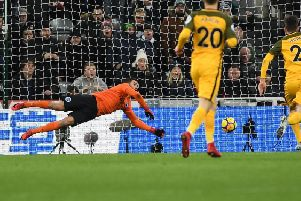 Mathew Ryan keeps out Dwight Gayle's header at Newcastle. Picture by Phil Westlake (PW Sporting Photography)