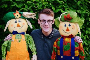 Nathan Dunbar with two scarecrows in Polegate