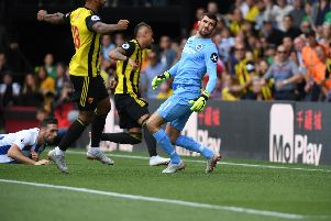 Watford's Roberto Pereyra wheels away after beating Maty Ryan for his second goal against Brighton & Hove Albion. Picture by PW Sporting Photography