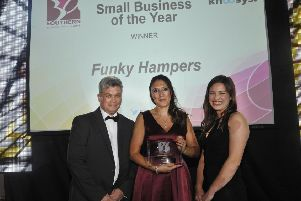 Small Business of the Year Winner Funky Hampers, Eastbourne (centre) & sponsor's Stephen & Katherine Khoo from Khoo Systems. SUS-180909-144640001
