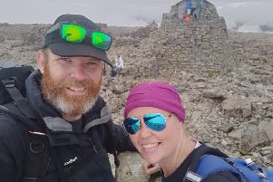Ieuan and Rosie Ford on top of Ben Nevis, the highest peak in the UK and included in their nine-peak challenge which saw them climbing mountains in England, Scotland and Wales SUS-180910-104927001