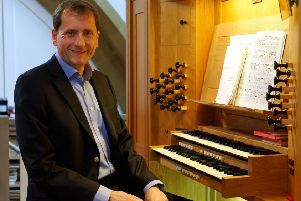 'Nic Robinson at the St Wilfrid's Church organ. Picture by Melvyn Walmsley