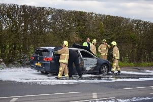 Firefighters on scene at the car fire on the A22 in Lower Dicker, photo by Dan Jessup