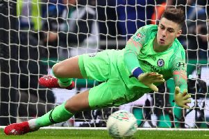 Kepa Arrizabalaga of Chelsea fails to save a penalty from Sergio Aguero of Manchester City in the shoot out during the Carabao Cup Final (Photo by Clive Rose/Getty Images)