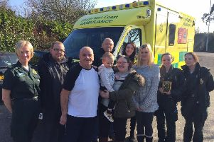 Stephen Massingham presents the plaque to the ambulance crews to thank them for saving his life