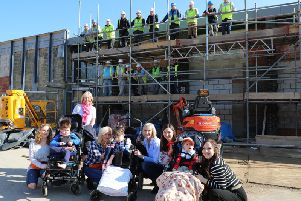 "Staff and pupils celebrate the ""topping out"" of local charity, Chailey Heritage Foundation's DREAM Centre"