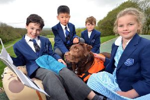 Pupils at Skippers Hill Manor Preparatory, in Mayfield, with labrador Lottie.  Photograph: Peter Cripps/ 24-4-19 (06)