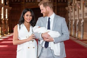 Prince Harry, Duke of Sussex, and his wife Meghan, Duchess of Sussex, pose for a photo with their newborn baby son in St George's Hall at Windsor Castle in Windsor, west of London on May 8, 2019. Photo: DOMINIC LIPINSKI/AFP/Getty Images