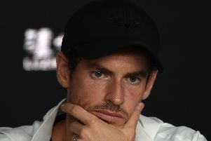 Britain's Andy Murray addresses media representatives at a press conference after defeat in his first round men's singles match against Spain's Roberto Bautista Agut on day one of the Australian Open tennis tournament in Melbourne early January 15, 2019. (Photo by Greg Wood / AFP) / -- IMAGE RESTRICTED TO EDITORIAL USE - STRICTLY NO COMMERCIAL USE --        (Photo credit should read GREG WOOD/AFP/Getty Images) SUS-190406-133408002