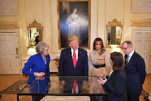 West Sussex County Archivist Wendy Walker delivered a presentation to President Donald Trump, Melania Trump, First Lady of the United States, Prime Minister Theresa May and her husband Philip May. Photo: MANDEL NGAN/AFP/Getty Images
