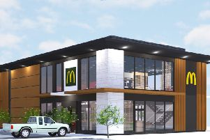 An artist's impression of how the new McDonald's will look, from the South Downs National Park Authority planning website