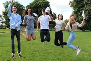 Bede's Sixth students Tom Poole, Megan Driver, Alastair Orr, Kate Perry and Katie Titmuss celebrating their A-level results today (August 15)