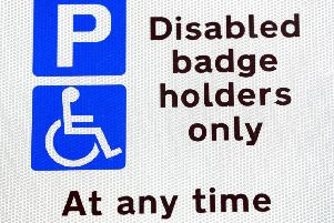 A disabled parking sign