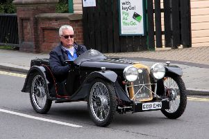 A swish classic car makes its way down Uckfield High Street photo by Ron Hill