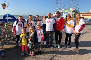 Walkers pose for a group photo before setting off on their pier-to-pier walk