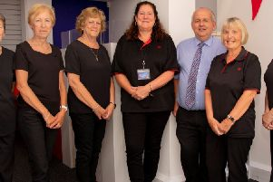 Staff at Hailsham's council run Post Office are celebrating six months since opening