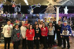 Staff at Paradise Park Garden Centre don festive knitwear for Christmas Jumper Day