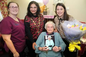 Stella Partridge, 100, with, from left, activities manager Lindsey Toomer, mayor Nazish Adil, and Lisa Laker. Photograph: Peter Cripps/ 8-1-20 (22)