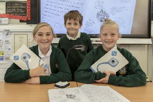 Pupils''Elsie, Samuel and Iris pictured with the new equipment at John Hampden School.