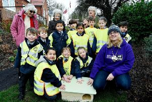 At Chiltern Lodge are pupils with residents, Debbie Endersby, Marion Taylor, Lucy Owens, and Kate Sheard from the Berkshire, Buckinghamshire, Oxfordshire Wildlife Trust.