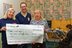 Chris Fram, right, presents the cheque to Nick Francis and Linda Emery, Thame Youth Caf� patron.