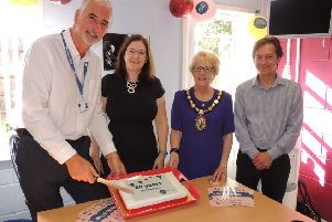 Cutting the 80th anniversary cake for Citizen's Advice. From left - CEO for Citizens Advice Mid Lincs Kingsley Taylor, MP Dr Caroline Johnson, NKDC chairman Coun Susan Waring and Citizens Advice Mid Lincs chairman Ben Ellis. EMN-190917-122909001