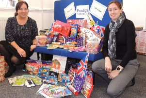 From left - Beata Biernacka - care co-ordinator, and Charlotte Walton-Gollop - branch manager at Prestige Nursing and Care with their collection of selection boxes and toys. EMN-190912-231222001