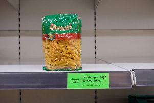 Almost-empty shelves where pasta would normally be stocked are pictured inside a supermarket store in north London (Photo: ISABEL INFANTES/AFP via Getty Images)